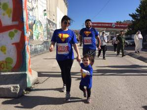 Saleem and Lubna Anfous were longing to see their first daughters' steps. They run the marathon every year since their daughter was 3-months old. Saleem wants to see her a 'super-girl' in the future, successful Palestinian girl who fights peacefully for her freedom.